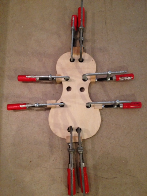 violin mould with blocks clamped in place