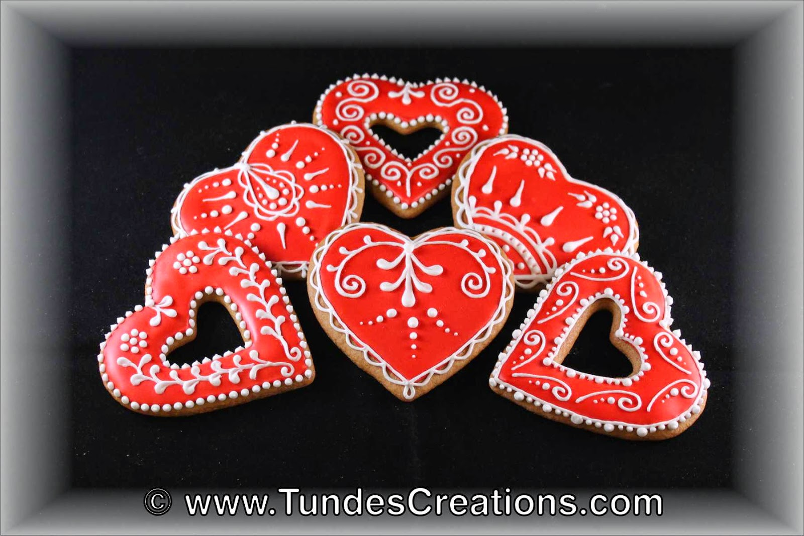 Red and white traditional Valentine's gingerbread hearts.