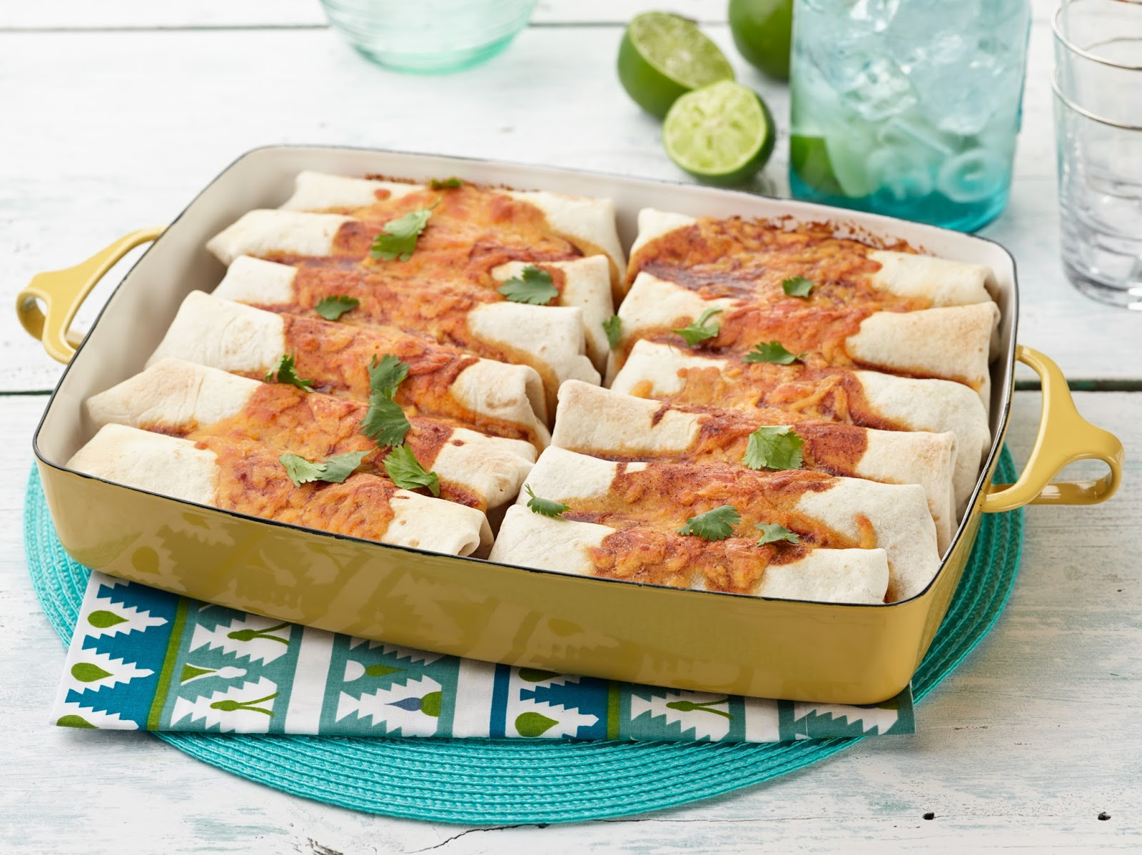 Beef and Bean Burritos- The Pioneer Woman. Ground beef, 2 lbs. 1 medium onion, diced; 1/2 tsp ground cumin; 1/4 tsp oregano; 1/4 tsp chili powder; 1/4 tsp salt; 14 oz. enchilada sauce; 28 oz. refried beans; 3/4 cup grated cheddar cheese, plus more for sprinkling on top; 12 burrito-size flour tortillas; fresh cilantro; In a large skillet over medium heat, cook the ground beef and onion.