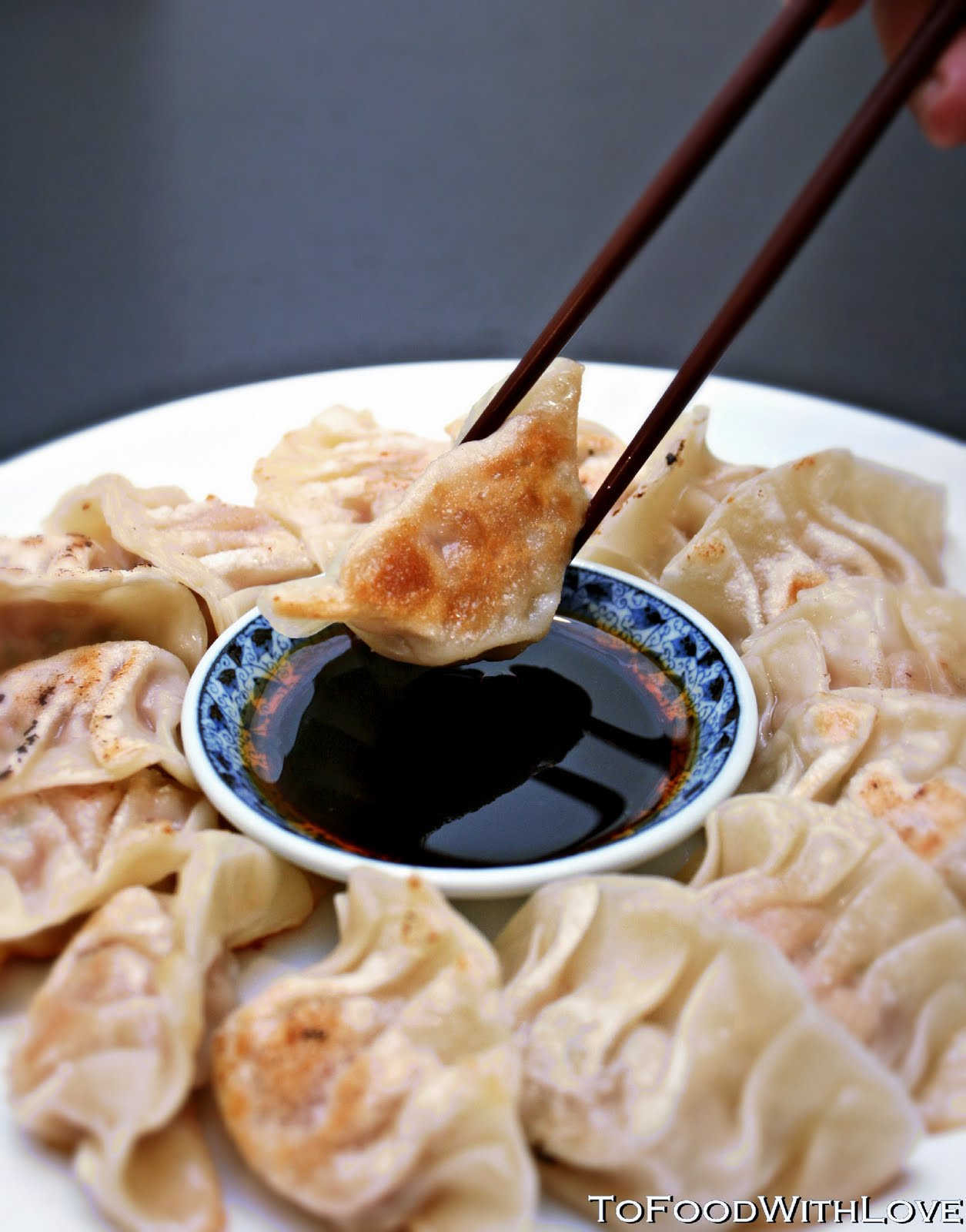 Gyoza served with a soy, black vinegar, chilli and sesame oil dipping ...