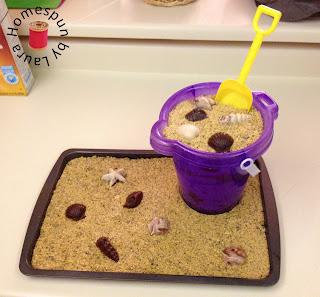 beach cake with sand bucket