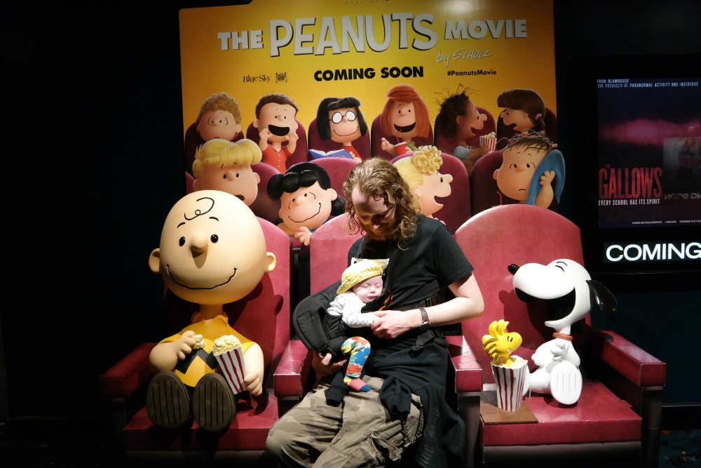 Steve and Matilda at the cinema on Peanuts Movie standee