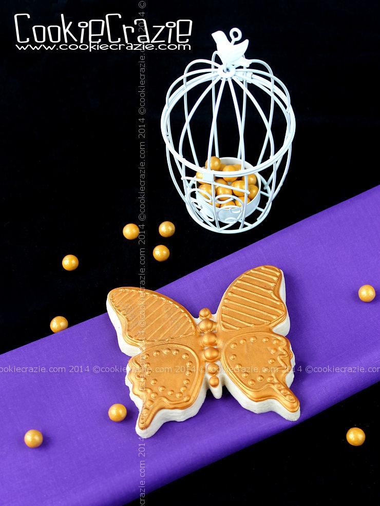 http://www.cookiecrazie.com/2014/09/golden-butterfly-cookie-tutorial.html