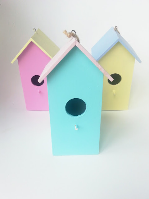 painting birdhouses to brighten up the garden