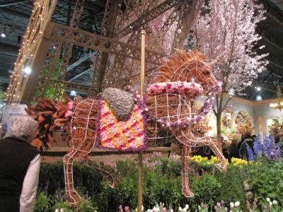 carousel unicorn made of flowers