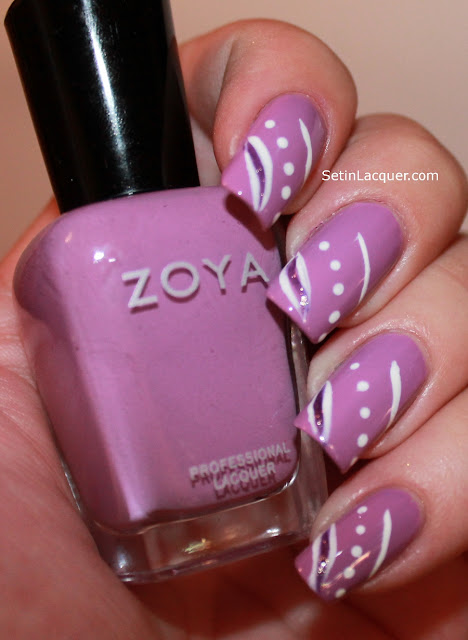 Zoya Perrie with random stripes and dots.