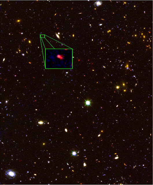 This image from the Hubble Space Telescope CANDELS survey highlights the most distant galaxy in the universe with a measured distance, dubbed z8_GND_5296. The galaxy's red color alerted astronomers that it was likely extremely far away, and thus seen at an early time after the Big Bang. A team of astronomers led by Steven Finkelstein of The University of Texas at Austin measured the exact distance using the Keck I telescope with the new MOSFIRE spectrograph. They found that this galaxy is seen at about 700 million years after the Big Bang, when the universe was just 5% of its current age of 13.8 billion years.  Image credit: V. Tilvi, S.L. Finkelstein, C. Papovich, A. Koekemoer, CANDELS, and STScI/NASA