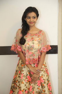Actress Nithya Shetty Stills in Floral Dress at Padesave Audio Launch CelesbsNext 25282