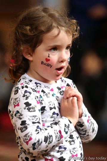 "Laila Armstrong-Armenanzas, 4, Napier, with ""I love rugby"" face-paint, at Fan Fiesta, Napier Municipal Theatre, Napier, celebrating today's rugby test at McLean Park, Napier, between Argentina's Los Pumas and the All Blacks. photograph"