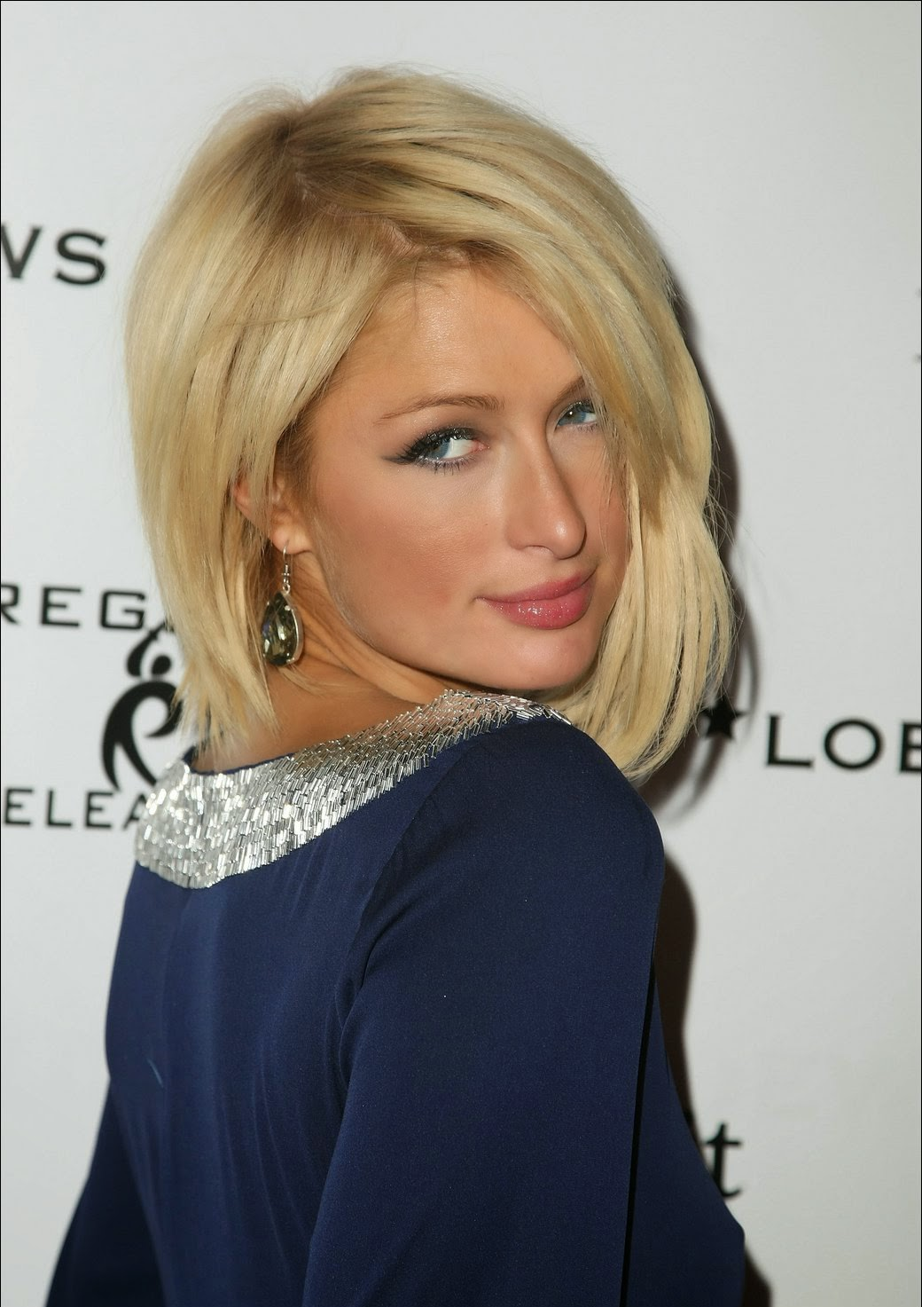 Paris Hilton wearing Jenny Dayco earrings