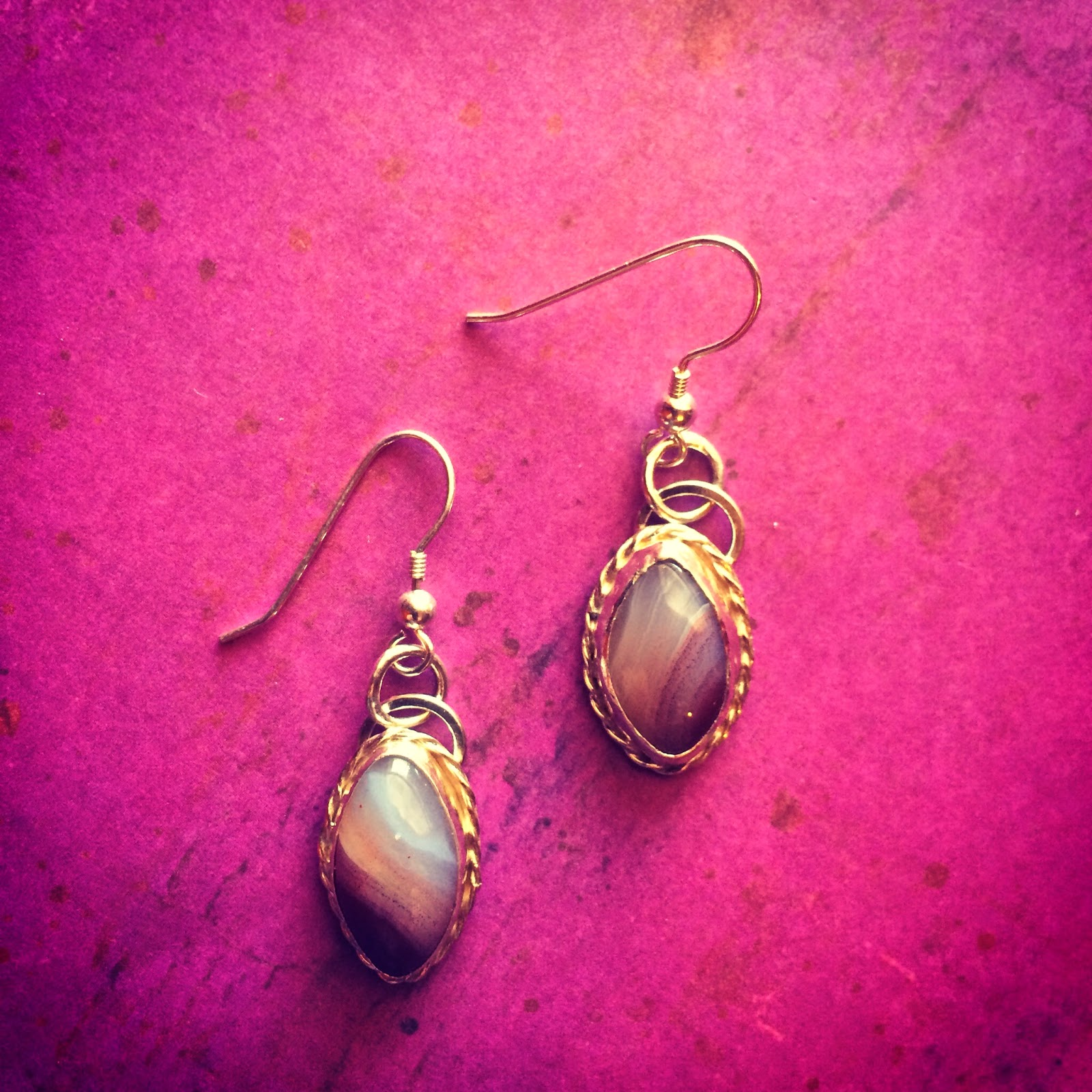 Silver earrings with silver twisted wire around banded agate stones