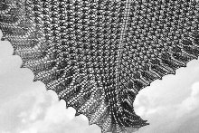 Clickable image of a hand knitted shawl.