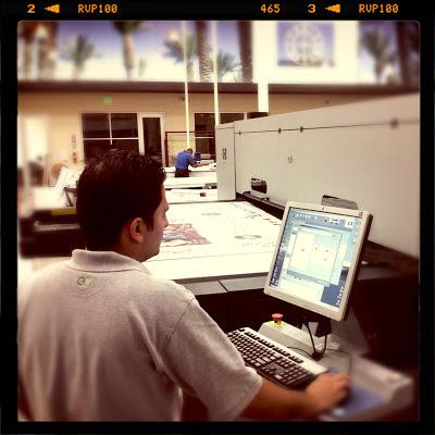 GotPrint digital print warehouse and GotPrint employee at the machine