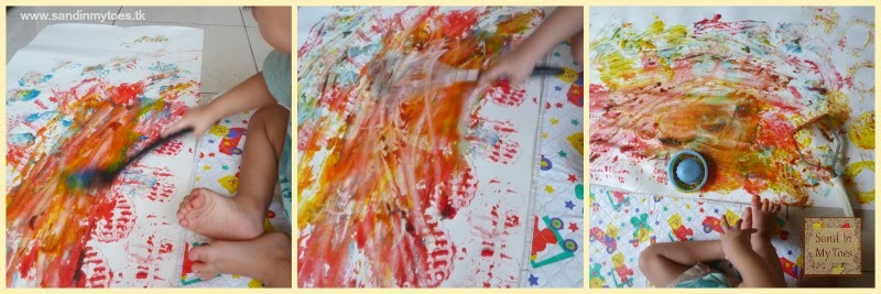 Toddler Painting with Kitchen Tools
