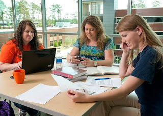 Students study in the Woodlands Center.