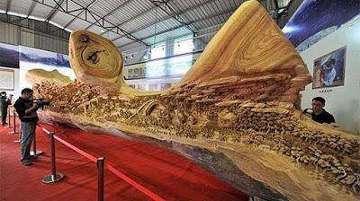 Seniman Zheng Chunhui Membuat Ukiran 3 Dimensi di Batang Kayu Besar