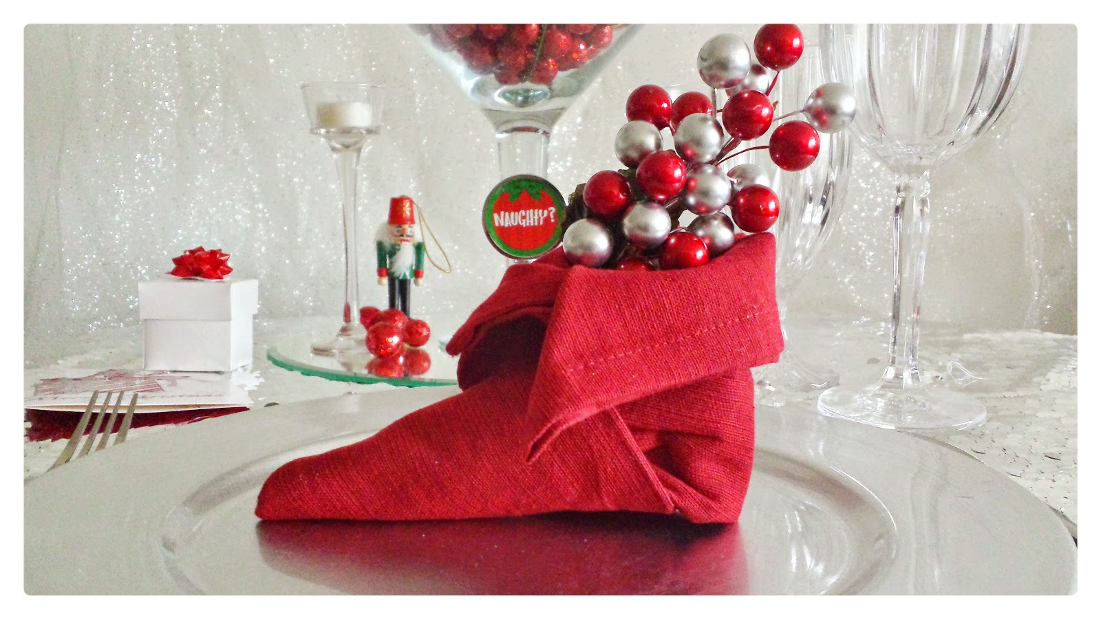 christmas table napkin folded into elf shoes