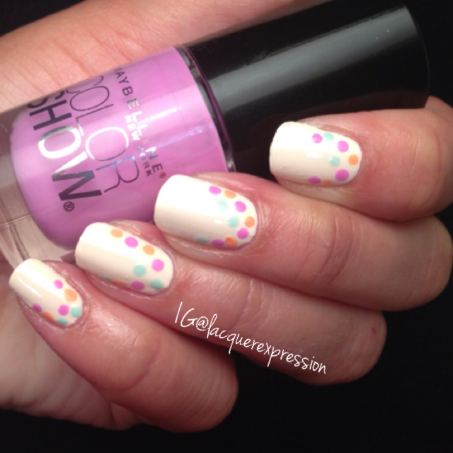 Reverse French dotticure using Lust for Lilac pastel polish by Maybelline