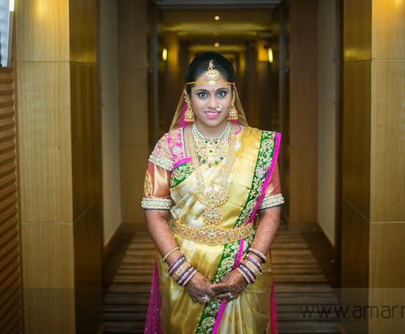 Bride in Pink and Gold Work Saree