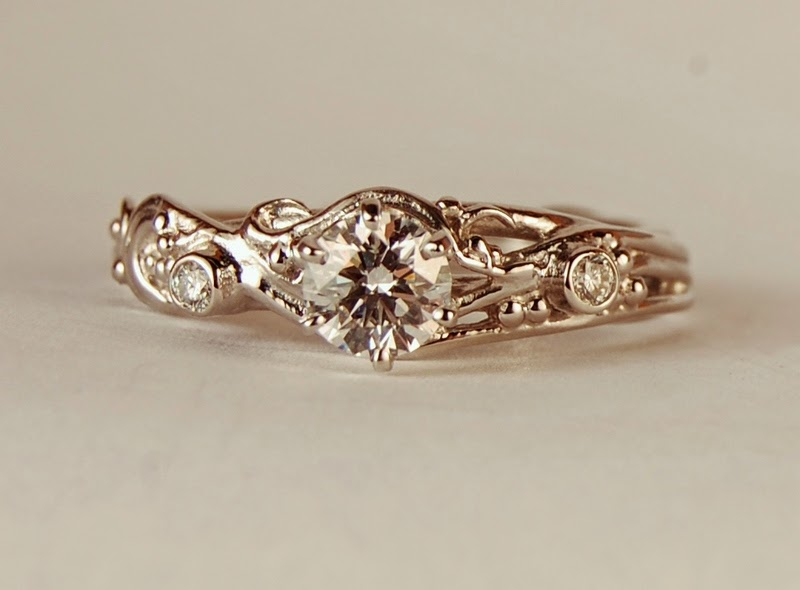 Platinum ring with three diamonds in an open wirey like design