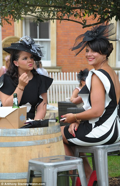 pretty ladies in black and white outfits on day 4 of Royal Ascot 2014