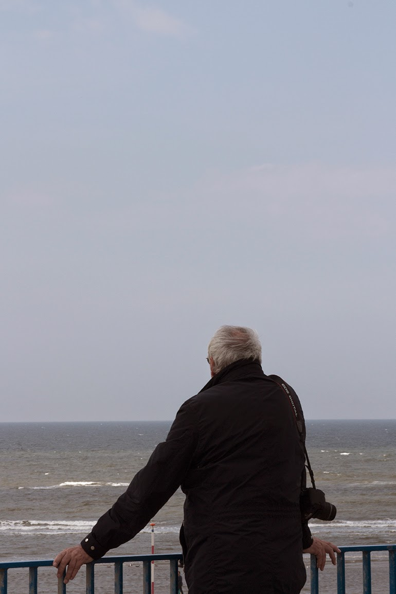 man looking at sea