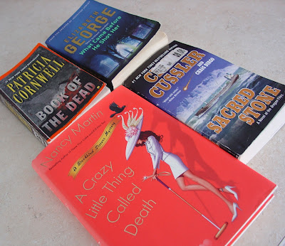 4 books that Vicky has recently read:  A Crazy Little Thing Called Death by Nancy Martin, Sacred Stone by Clive Cussler, Book of the Dead by Patricia Cornwell, and What Came Before He Shot Her by Elizabeth George