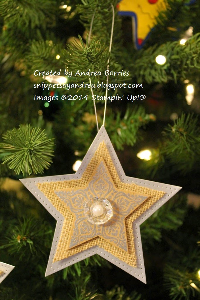 A star-shaped Christmas ornament made with layers of silver paper, burlap and stamped kraft paper.