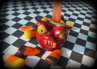 Evil-Candy-Apple-Polymer-Clay-sculpt-by-Marie-Young-Creative
