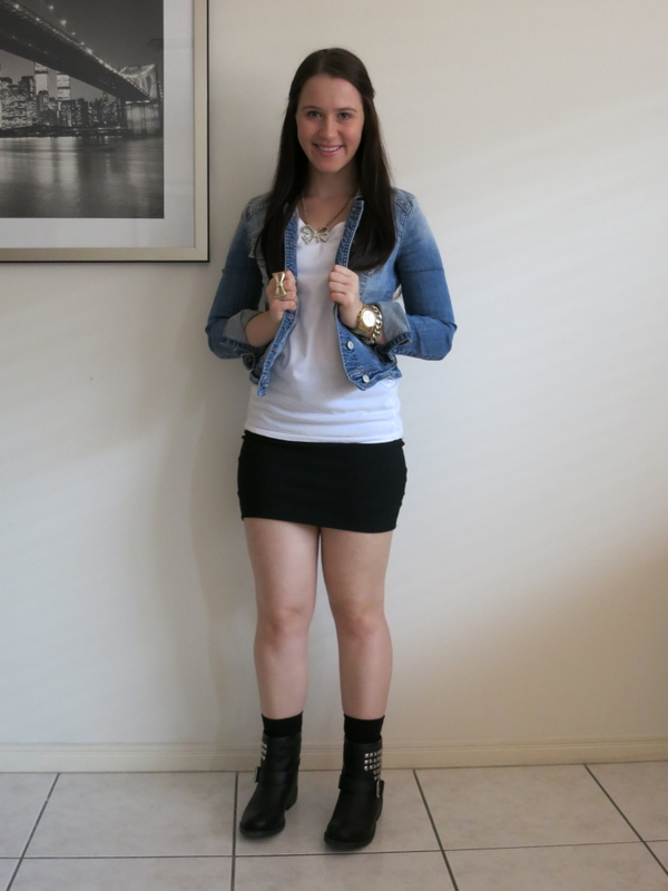 Black bandage skirt, cream t-shirt, denim jacket, black biker boots and gold jewellery.