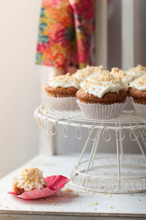 Strawberry & almond muffins with cream cheese frosting and amaretto biscuit crumbs