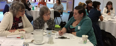 librarians at table talking