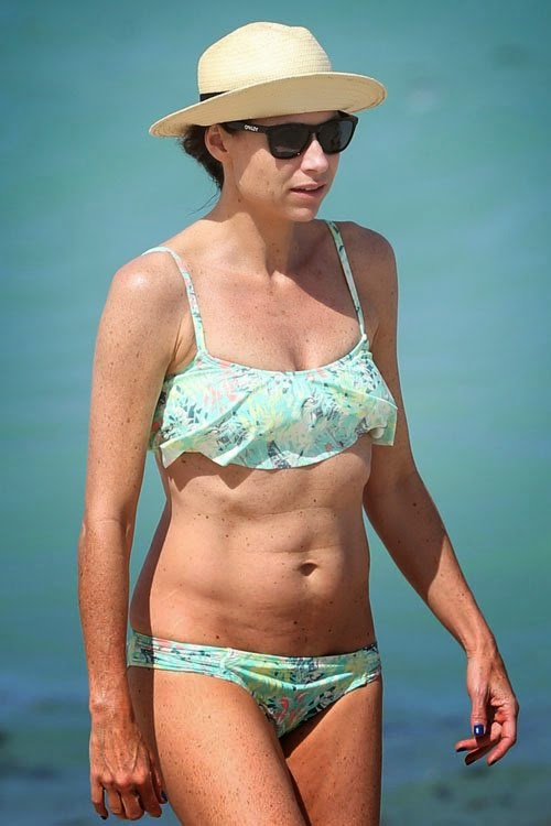Minnie Driver sizzles in an Aquamarine Bikini as she walks by herself in Miami