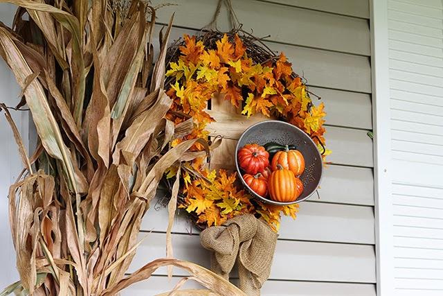 Fall porch decor with cornstalks, DIY wreath, and chevron pillows @ houseofhawthornes.com