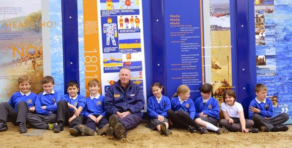 Scarborough RNLI lifeboat mechanic Dave Horsley and children from Year 4 at the town's Gladstone Road Primary School