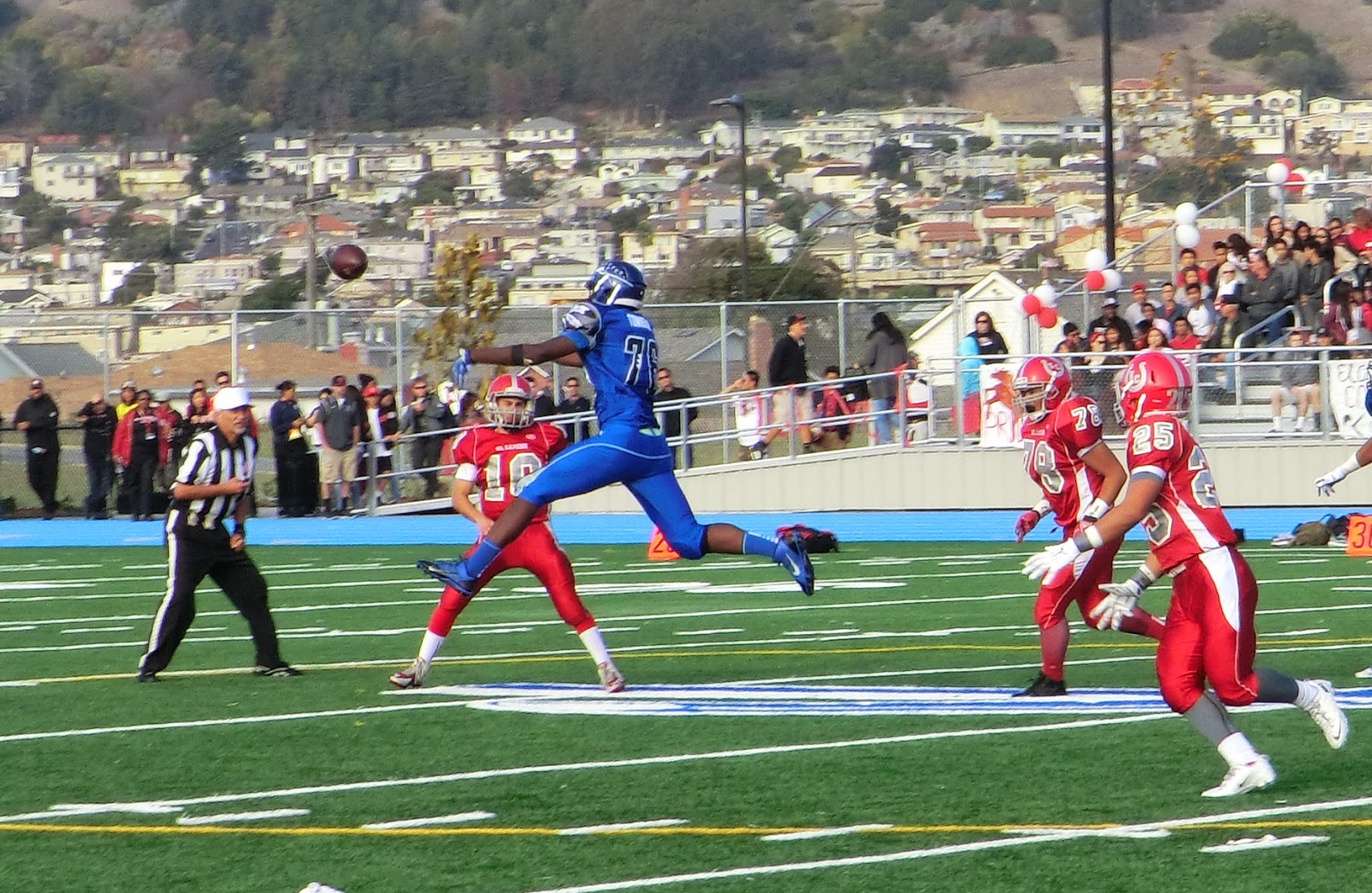 South City's Terrell Townsend knocks down a pass from EC's Andrew Pierotti late in the first half.