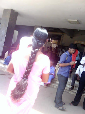 Indian college girl with thick braid.