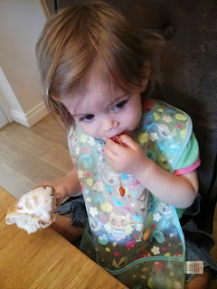 youngest enjoys her cake