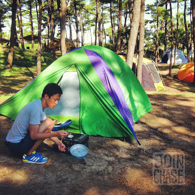 A Korean man makes a meal while camping on Jeju Island in South Korea.
