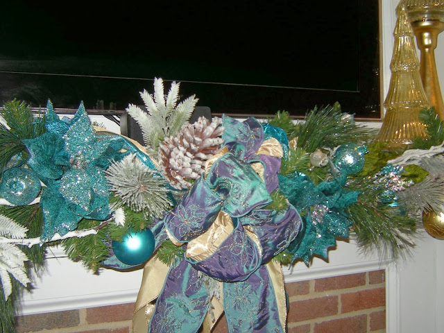 mantel, garland, christmas decor, teal christmas decor, flocked-pinecones