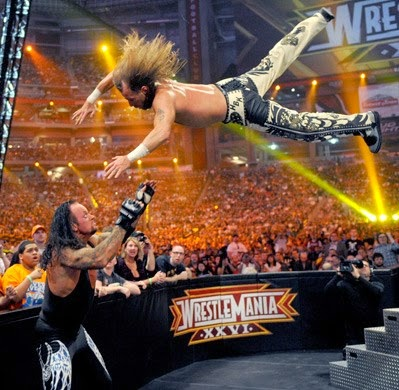 Shawn Michaels dives outside the ring