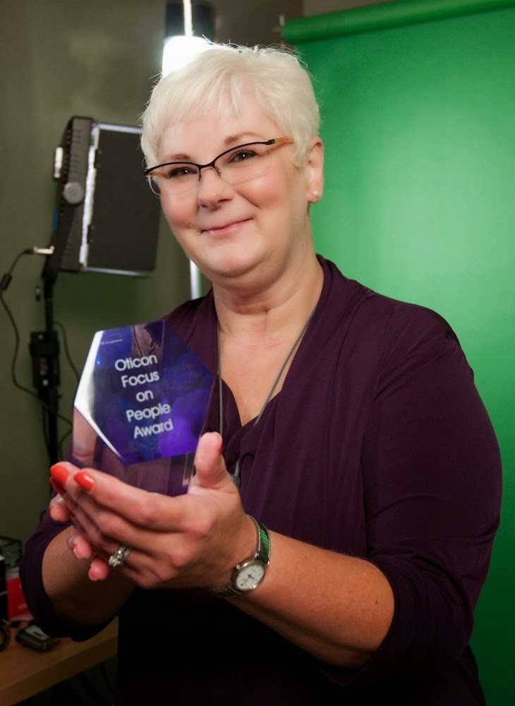 Joyce, who runs http://xpressivehandz. blogspot.com is seen here with an award.
