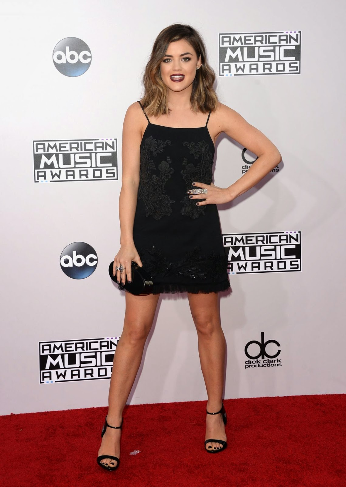 Lucy Hale wears an embellished black mini dress at the 2014 American Music Awards