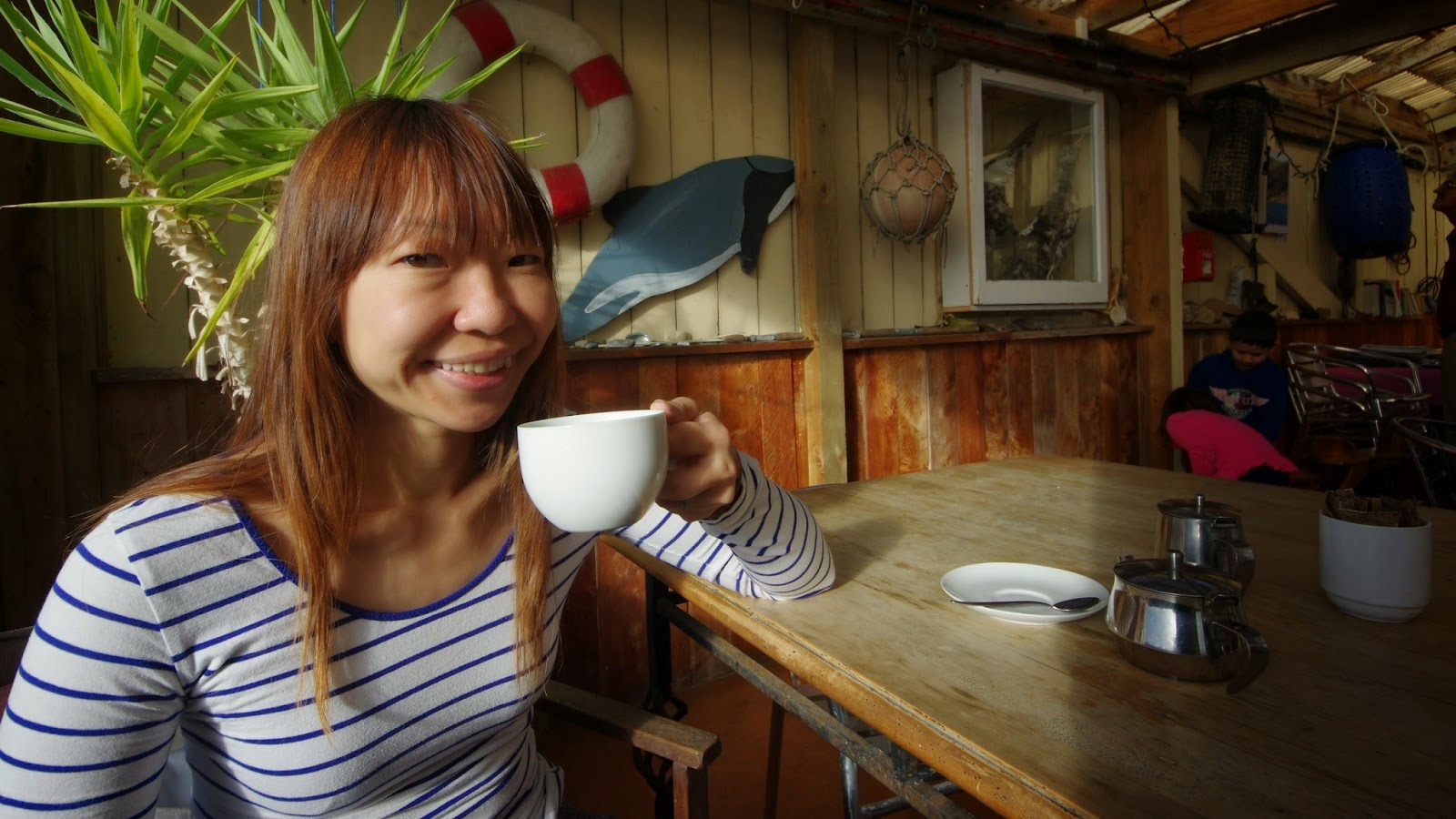 Gratuitous tourist having a coffee