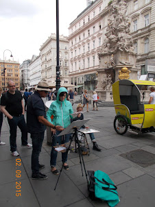 """Artist on Stephansplatz sketching  """"Watercolour Drawings"""" for Tourists purchase."""