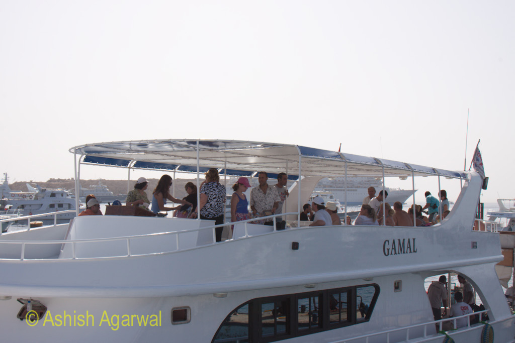 Tourists at the upper level of the small ship at the Red Sea in Sharm el Sheikh in Egypt