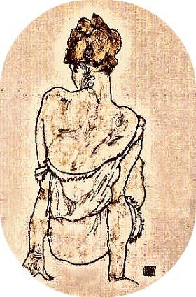 Donna seduta di schiena