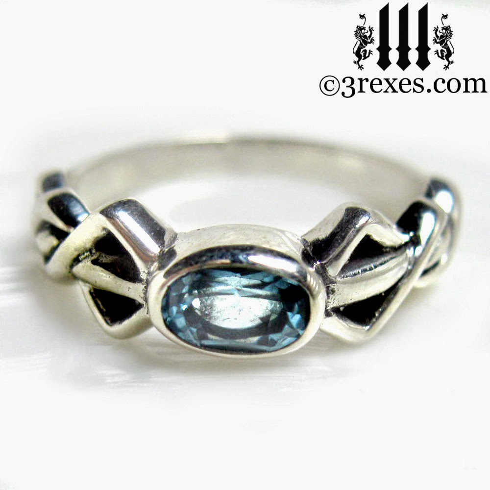 silver pixie friendship ring with celtic blue topaz