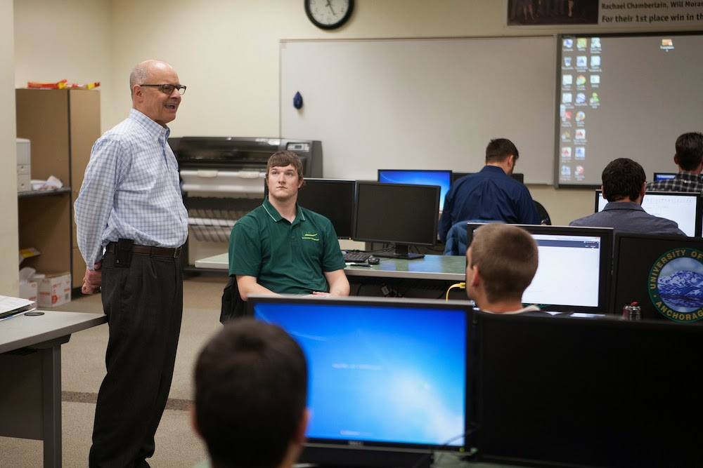 Professor Donn Ketner speaks to students in his capstone construction management class. (Photo by Philip Hall/UAA)