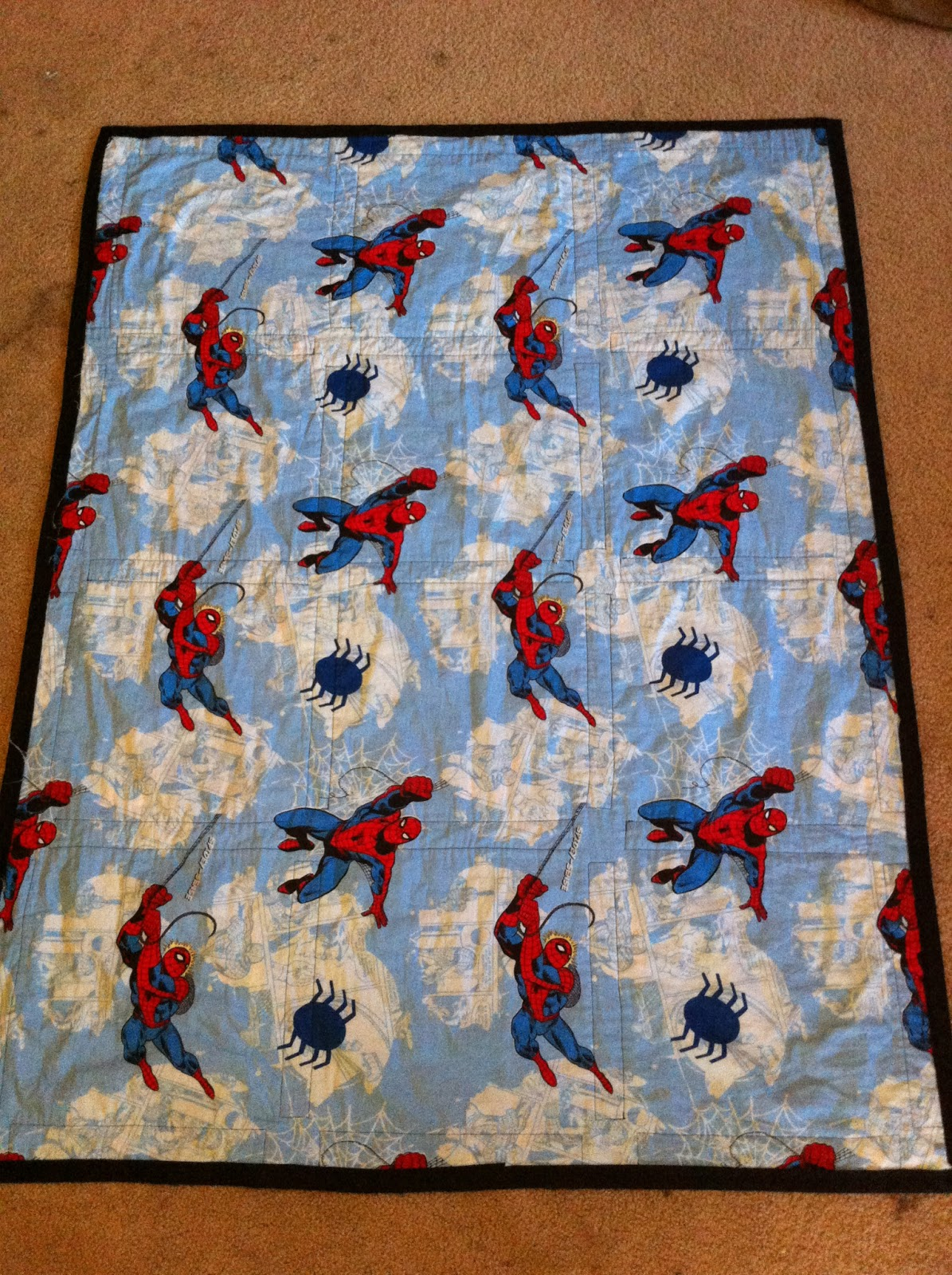 Between the rabbit 39 s ears marvel quilts for Jake quilted bedding